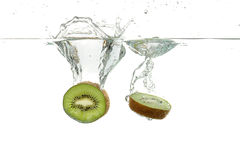 Kiwis making a splash. Into water on a white background Stock Images