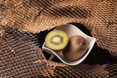 Kiwis and paper textured background stock photos