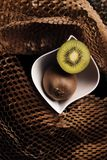 Kiwis and paper textured background stock photo