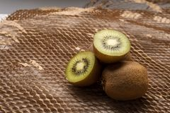 Kiwis and paper textured background royalty free stock images
