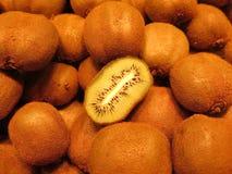 Kiwis. Plenty kiwifruit skin and half stock photo
