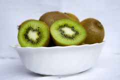 Kiwis on the white plate Stock Photography