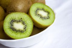 Kiwis on the white plate Royalty Free Stock Images