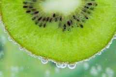 Kiwivattenfärgstänk Arkivfoto