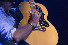 Kix Brooks plays guitar. Country Western star Kix Brooks plays his guitar during a concert Royalty Free Stock Images
