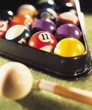 Kiy with pool balls Stock Images