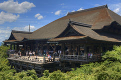 Kiyomizu-dera. Tourists at Kiyomizu-dera in Kyoto, Japan. Founded in the 700's, the present structure dates from 1633 an is built without a single nail. The Stock Images