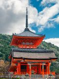 Kiyomizu-dera Buddhist Temple West Gate in Kyoto. Kiyomizu-dera Buddhist Temple West Gate building on a beautiful morning against mount Otowa forest, in Gion royalty free stock photography