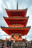 Kiyomizu-dera Pagoda of the Buddhist Temple, in Kyoto, Japan. Kyoto, Japan -November 2, 2018: Bright orange impressive architecture of the Pagoda Tower of the royalty free stock photos