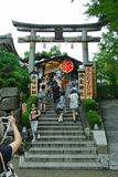 Kiyomizu Dera Temple. Tourists taking pictures near the Jishu Shrine gate at the kiyomizu-dera temple in Kyoto Japan on a overcast day Stock Image