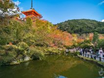 Kiyomizu temple and autumn colors reflected in the water in Kyoto, Japan. Kyoto, Japan - November 2, 2018: Mirror Pond and promenade ar the famous Kiyomizu-dera royalty free stock photo