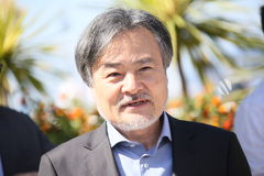 Kiyoshi Kurosawa attends the `Before We Vanish Sanpo Suru Shinr. Yakusha` photocall during the 70th annual Cannes Film Festival at Palais des Festivals on May 21 royalty free stock photo
