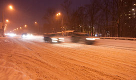 Kiyv night traffic in a snowstorm Royalty Free Stock Images