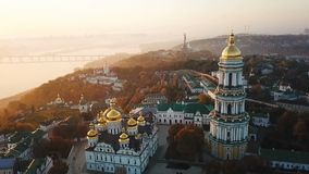 Kiyv Ukrainian capital city. Kiev Pechersk Lavra. Aerial drone video footage. View to rider Dnipro and bridge. Fog and. Sunrise light. Amazing view. golden stock video footage