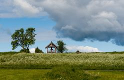 Kizhi landscape with the cross on the hill in Sunny day stock photography