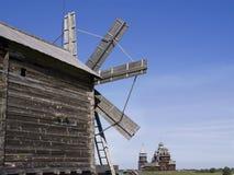 Kizhi. A windmill and Preobrazhenskiy church Royalty Free Stock Images