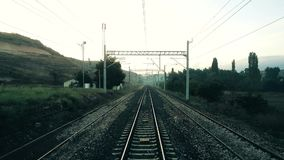Rural scene through the passenger train window in Eskisehir, Turkey. Kizilinler, Eskisehir, Turkey - October 09, 2017: Real time footage of a train passing by a stock footage