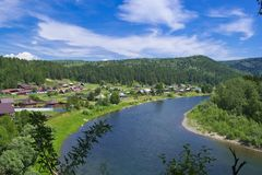 Kizir river. River and village in Siberia Royalty Free Stock Photography