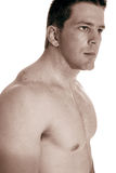 KJ looking serious. Body builder looking serious over white Stock Photo