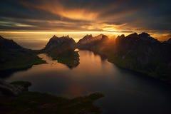 Kjerkfjorden Midnight Sun. Sun at midnight over mountains and fjord, Lofoten Stock Photo