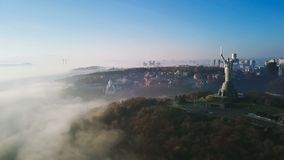 KKiev Ukraine The Motherland Monument USSR heritage. City hills on fog. Beautiful autumn morning. Aerial drone video. Footage. panoramic view. camera is stock video