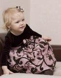 klädd flickawell Royaltyfria Bilder