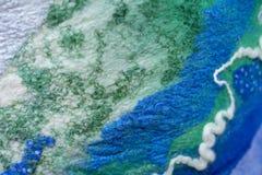 Klädd med filt blå grön abstrakt bakgrund royaltyfria foton