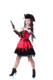 Klädd nätt flicka som piratkopierar, isolerat på vit royaltyfri foto