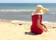 klädd röd kvinna Royaltyfri Foto