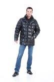kläder man ner vinterbarn Arkivbilder