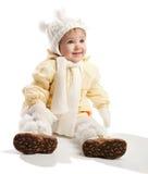 kläder som ler litet barnvinter royaltyfria foton