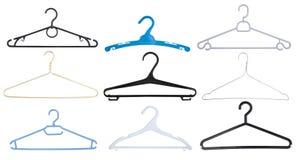 Klädhängare isolerad uppsättning på vit arkivfoto