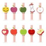Klädnypa med den färgrika funy äpplevektorn Fotografering för Bildbyråer