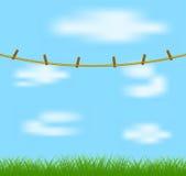 Klädnypor på rep och blå himmel Royaltyfria Bilder