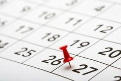 Klämma fast datumet nummer 27 Fotografering för Bildbyråer