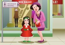 klänning för shoppingmammaköpande Arkivfoton