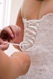 klänning som binds upp bröllop royaltyfria bilder