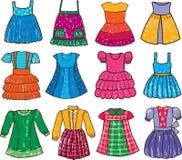 Klänningar för lite flicka Arkivfoton