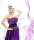 klänninginnegrejkvinna Arkivfoto