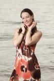klänninginnegrejkvinna Royaltyfri Fotografi
