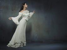 klänningkvinna Arkivfoto