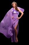 klänningpurplekvinna Arkivfoton