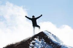 Klättrare överst av ett berg Arkivfoton