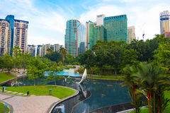 KL City Centre Park in front of Petronas Twin Towers, Kuala Lump. KUALA LUMPUR - JUNE 15, 2016: A view at the KL City Centre Park located in front of Petronas Royalty Free Stock Photography