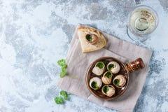 Klaar om Escargots DE Bourgogne slakken te eten Stock Afbeeldingen