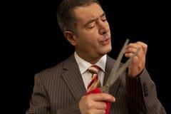 Klage-Ausschnittnägel scisors des Geschäftsmannes tragende Stockfoto