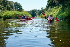 Canoeing by the river. Lithuania by the river Minija. royalty free stock photography