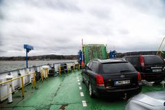 Klaipeda, Latvia - April 02, 2018: Cars on the ferry in Klaipeda near Curonian spit royalty free stock images