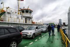 Klaipeda, Latvia - April 02, 2018: Cars on the ferry in Klaipeda near Curonian spit royalty free stock photo
