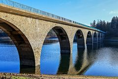 Klamer Bridge over the Versetalsperre in the Sauerland, Germany. The Klamer stone arch bridge is a transition over a side arm of the Vers Trinkwassertalsperre in royalty free stock image